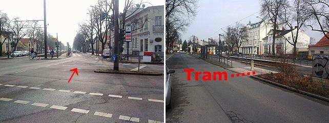 Blick von der Kreuzung in Richtung rote Schule und auf den vorderen Haltestellenbereich der Tram